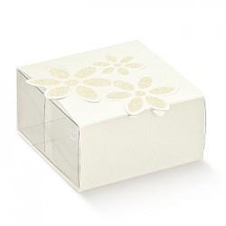Embalaje PET y cartón blanco con flor impresa.